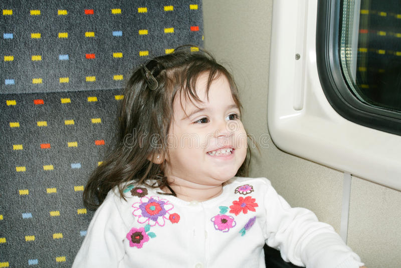 Little girl looking window stock photos