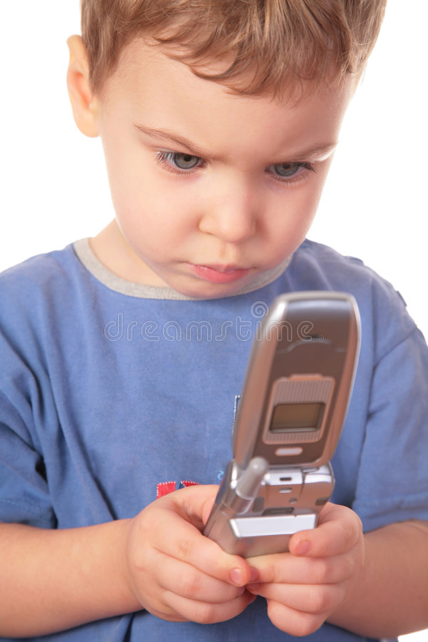 Little girl looks on cell phone. On white royalty free stock photo