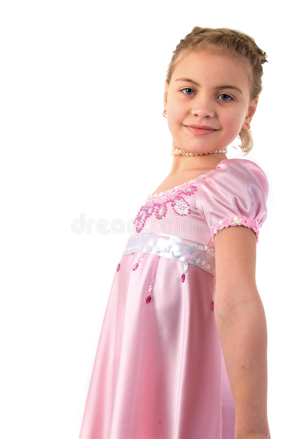 Little Girl Looks Princess In Beautiful Dress. royalty free stock images