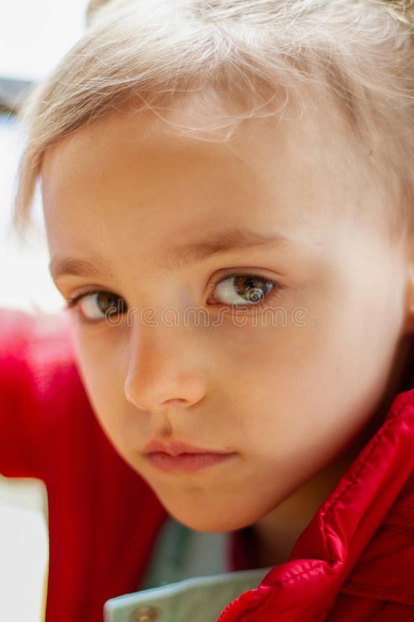 Little girl looks sad with big eyes royalty free stock images