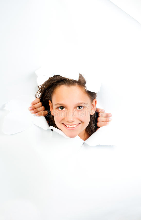 Little Girl Looks With Sheet Of Torn White Paper Stock Images