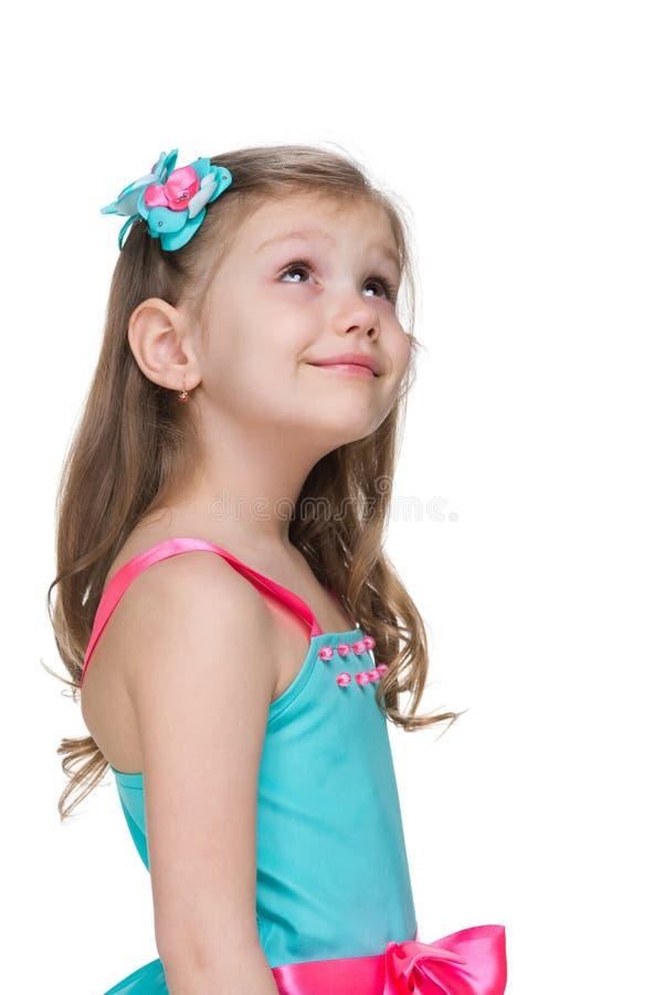 Little girl looks up stock image