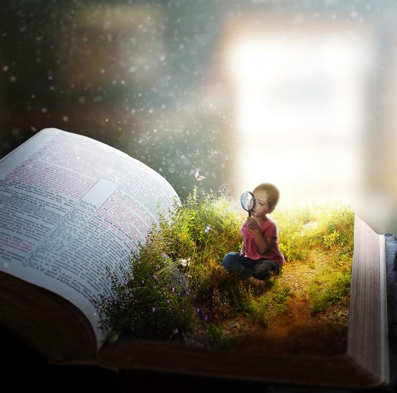 Little girl lost in the pages. A little girl watches butterflies on the pages of an open Bible stock photography