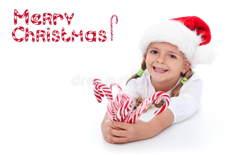 Little girl with lots of candy canes royalty free stock photos