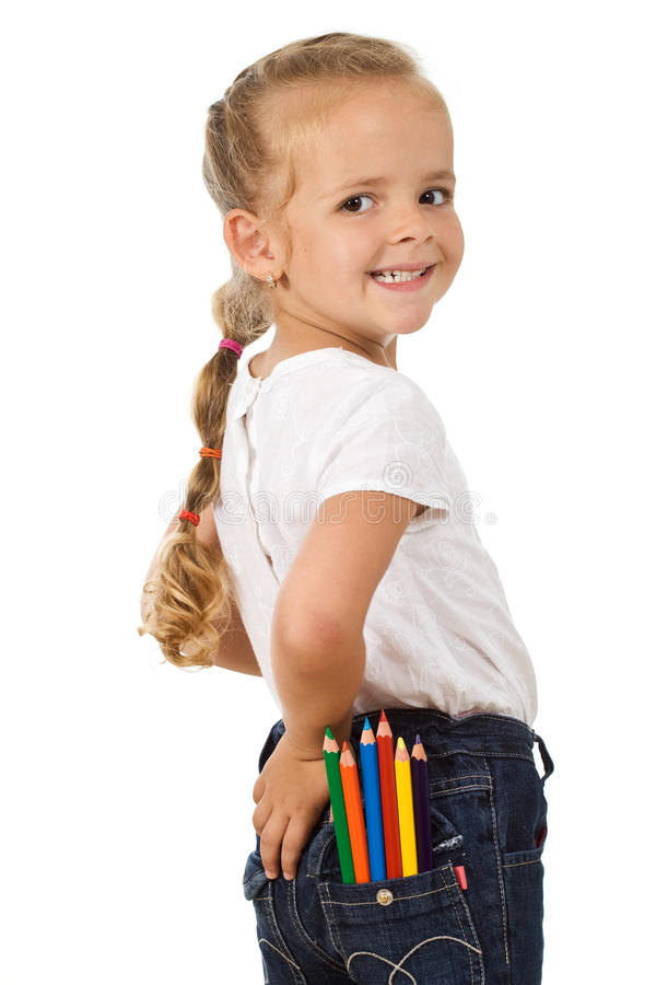 Little girl with lots of pencils in her pocket royalty free stock photography