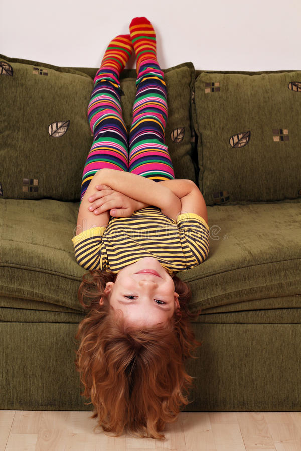 Download Little Girl Lying On The Bed Stock Photo - Image: 26818636