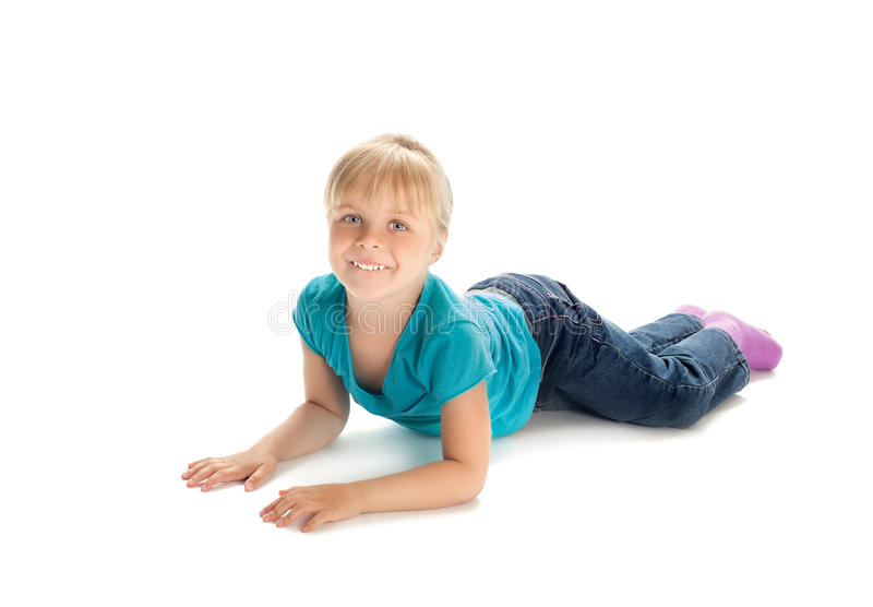 Little girl lying on the floor royalty free stock images