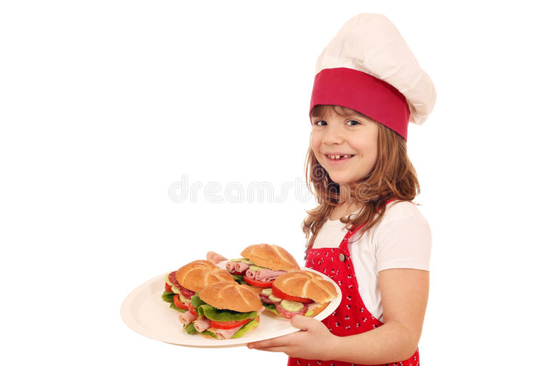 Little girl make sandwiches stock photos