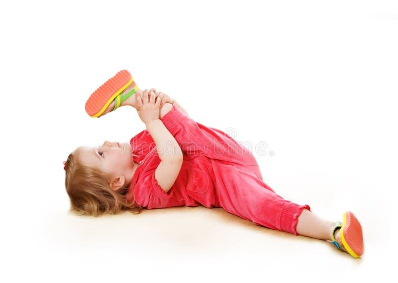 Little girl makes pilates stock photo