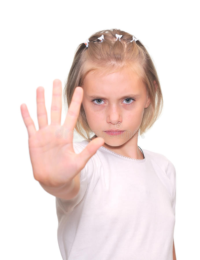 Little girl is makes a stop gesture stock photo