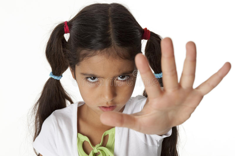 Little girl is makes a stop gesture with her hand royalty free stock image