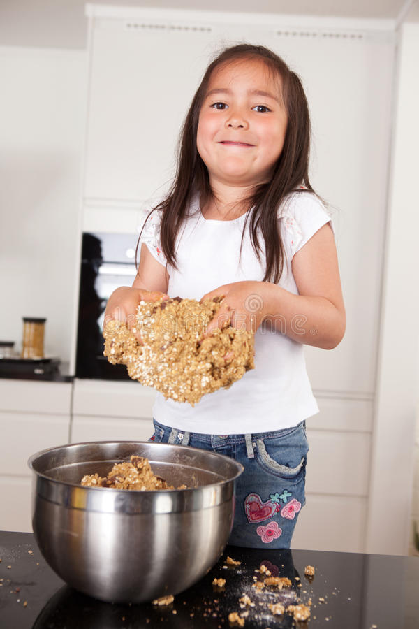 Little Girl Making Cookies stock photo