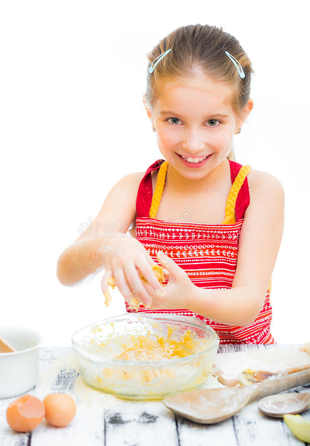 Little girl making dough. Cutre little girl making dough, on a white background stock images