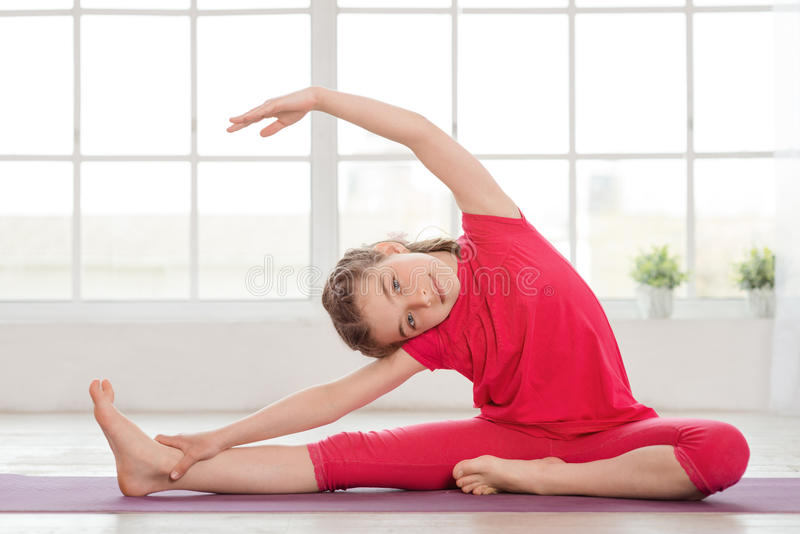 Little Girl Making Gymnastics And Stretching Stock Photo