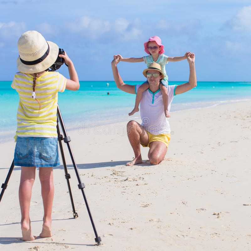Little girl making photo of her family royalty free stock photo