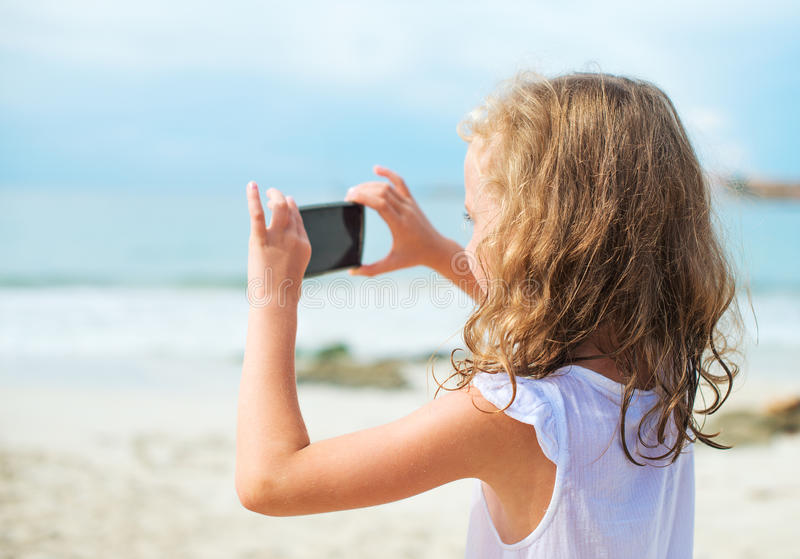 Little girl making video. royalty free stock photography