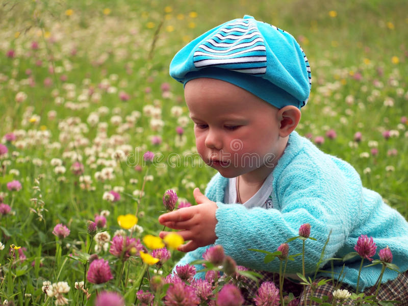 Little girl with many flowers royalty free stock photos