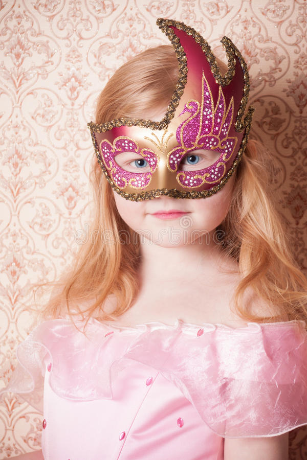 Little girl in mask royalty free stock image