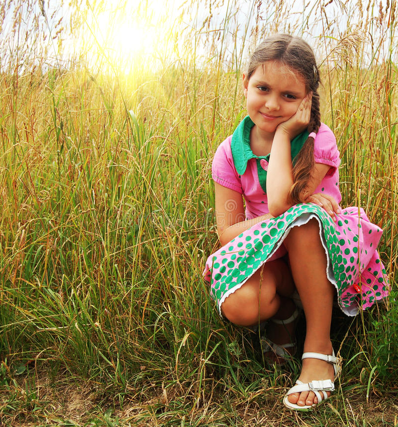 Little girl on the meadow royalty free stock image