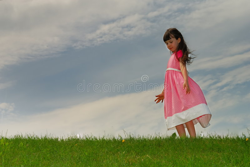 Little Girl In Meadow stock images