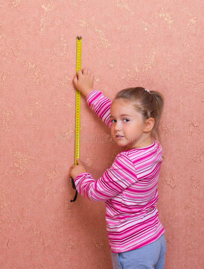 Download Little Girl With Measurement Tape Royalty Free Stock Photo - Image: 26610555