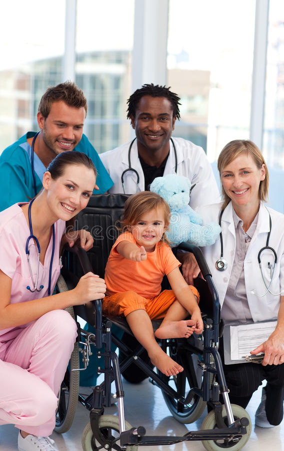 Little girl with medical team royalty free stock photography
