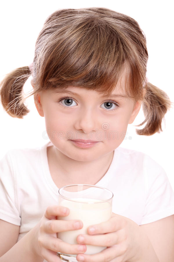 Little girl with milk royalty free stock photos