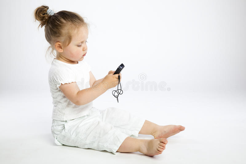Little girl with mobile phone royalty free stock photography