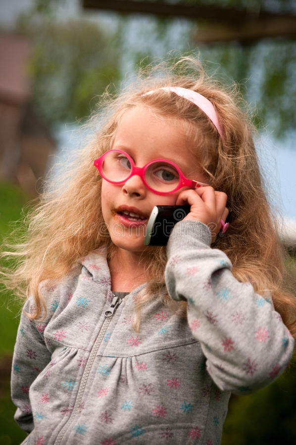 Little girl with mobile phone stock photo