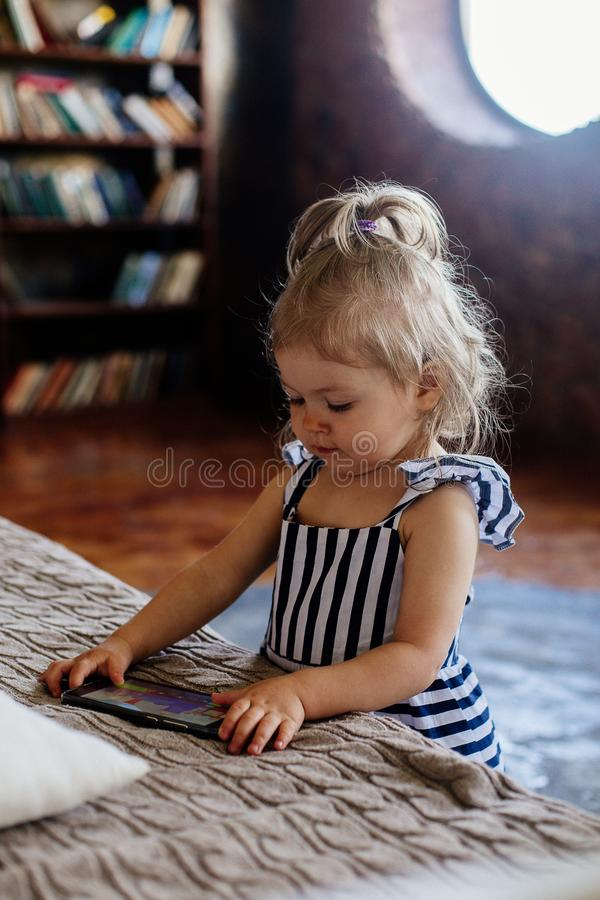 Little girl with mobile phone. royalty free stock photos