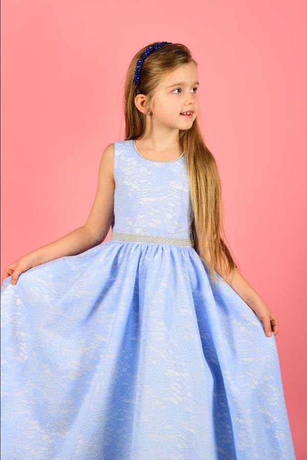 Little girl model, wedding, fashion concept - girl dressed in blue and blue dress smiling. Little girl model, wedding, fashion concept - girl dressed in blue stock image
