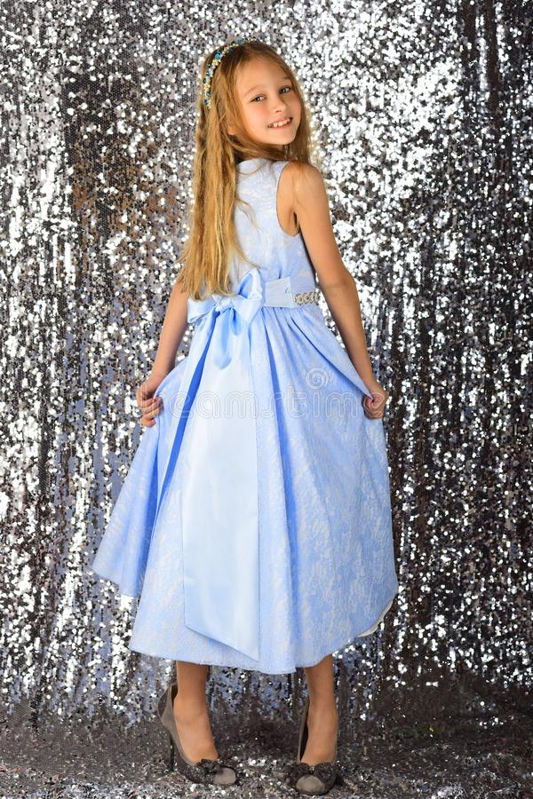 Little girl model, wedding, fashion concept - girl dressed in blue dress smiling.  royalty free stock photos