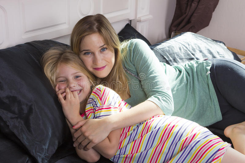 Little girl with mom together royalty free stock image