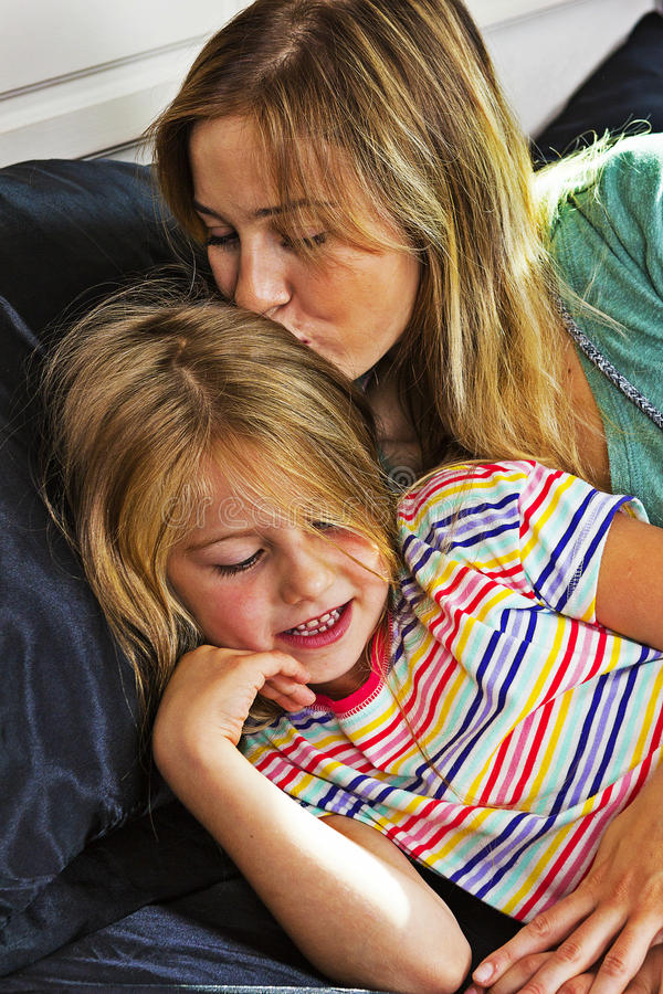 Little girl with mom together stock photography