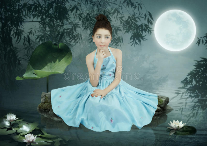 Little girl in the moonlight stock photos