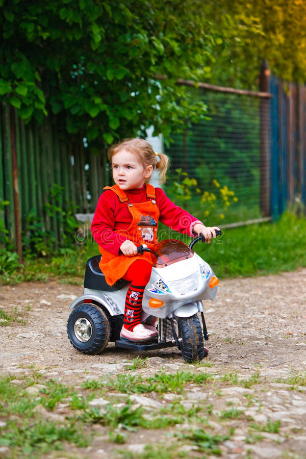 Download Little Girl On The Moped In The Country Stock Image - Image: 15144291