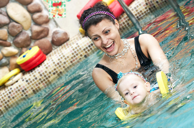 Little girl and mothe in swimming royalty free stock photos