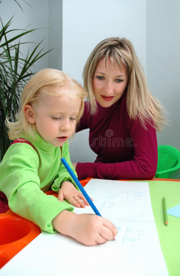 Download Little Girl With Mother Draws Pencil Stock Image - Image: 20761781