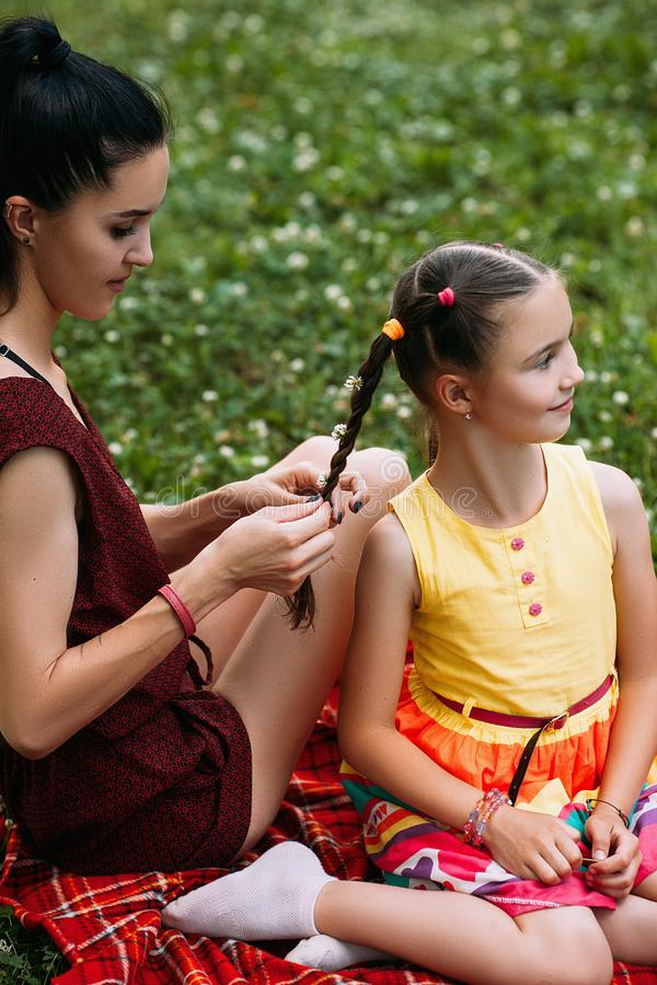 Little girl mother hairstyle picnic relax concept royalty free stock photography