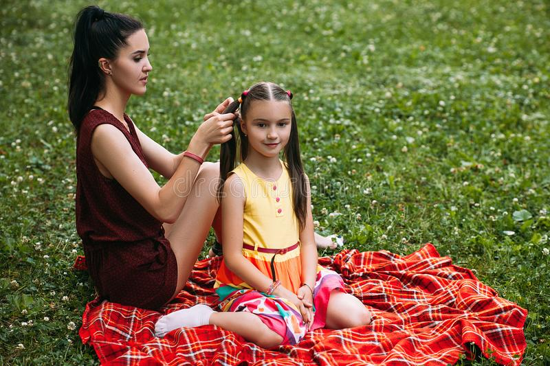 Little girl mother hairstyle picnic relax concept stock photos