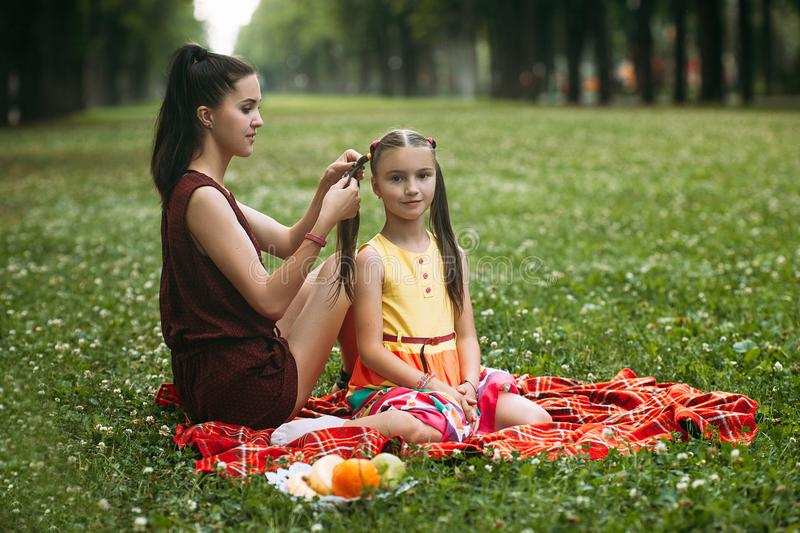 Little girl mother hairstyle picnic relax concept royalty free stock photos