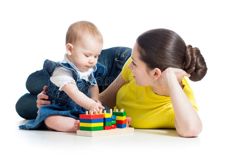 Little girl and mother play royalty free stock image