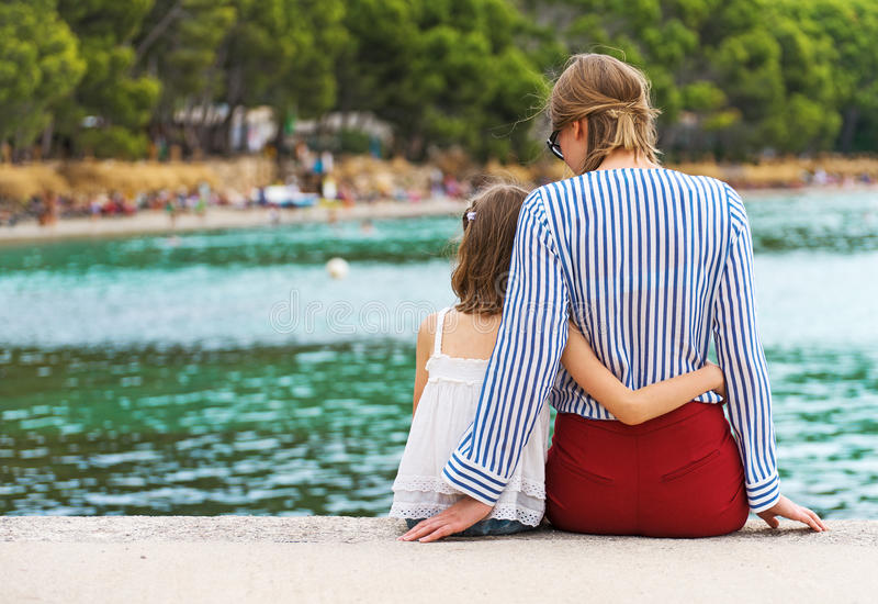 Little girl with mother. stock photos