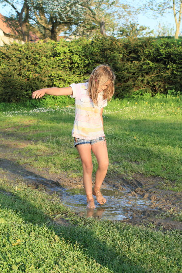 little-girl-muddy-puddle-happy-barefoot-