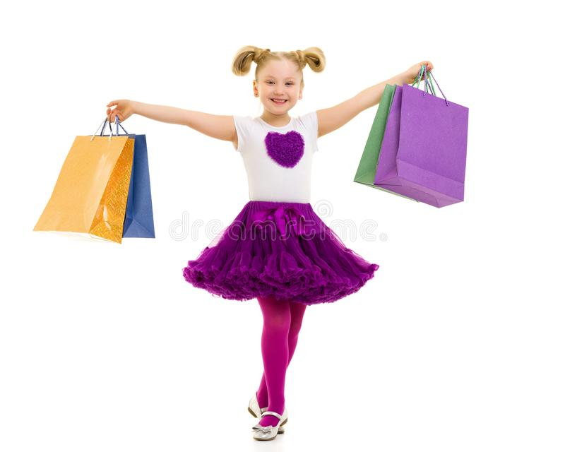 Little girl with multi-colored bags in their hands. stock photos