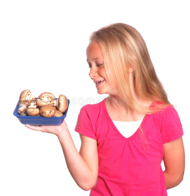 Little girl with mushrooms stock photos