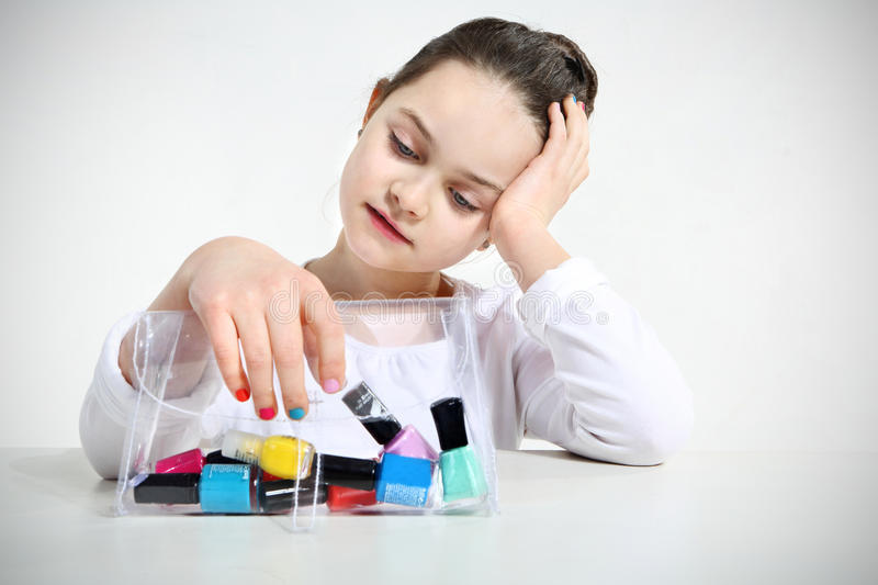 Little girl and nail stock image