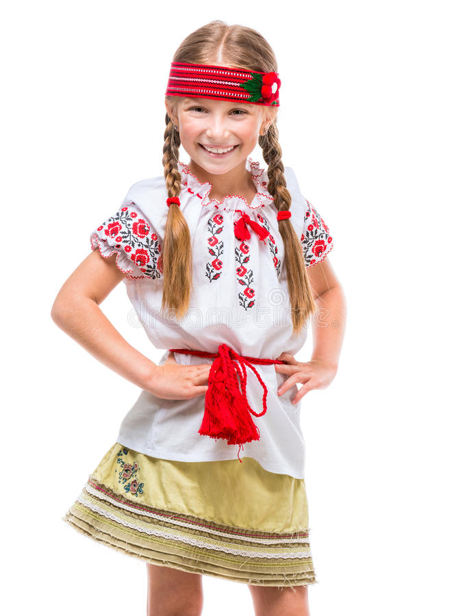 Little girl in the national Ukrainian costume. Cute happy little girl in the national Ukrainian costume isolated over white stock photos