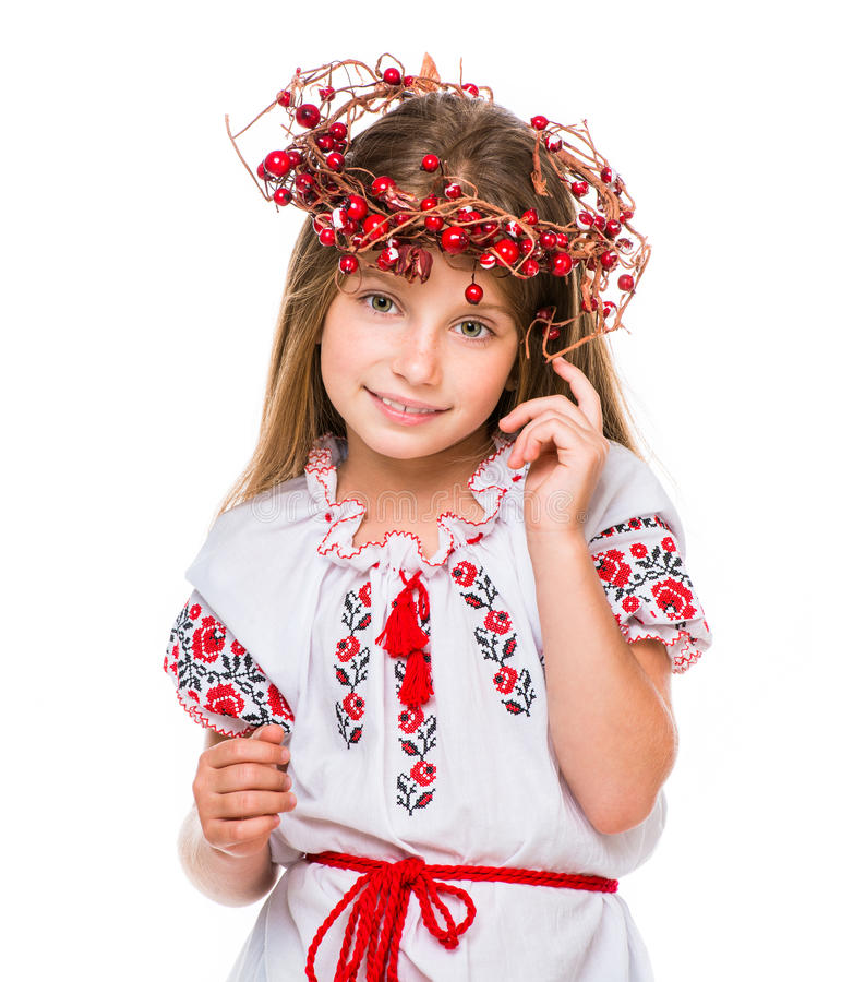 Little girl in the national Ukrainian costume. Cute happy little girl in the national Ukrainian costume over white royalty free stock photo
