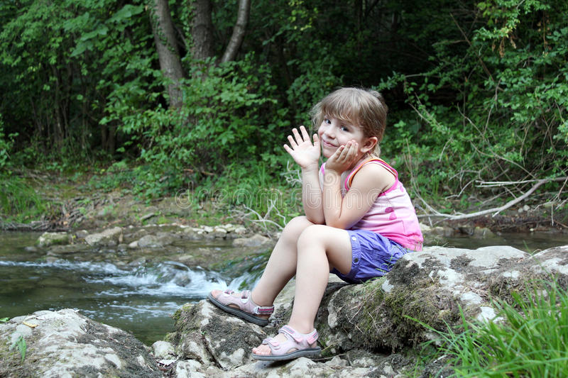 Download Little girl in nature stock photo. Image of river, outdoor - 26167708